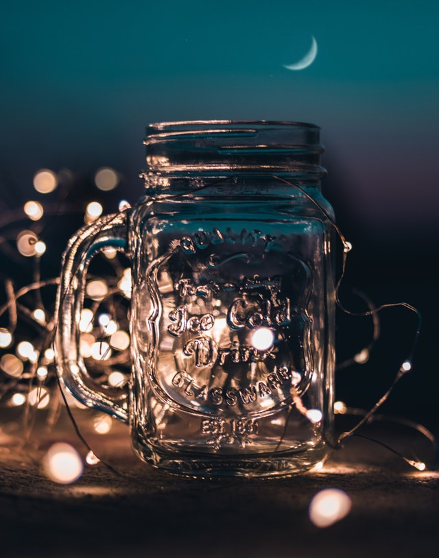 Mug with Fairy Lights on Background
