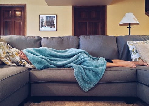 Men Sleeping on Couch